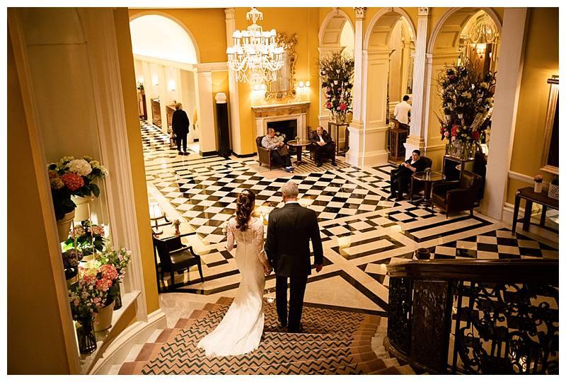 Claridge's summer wedding couple on staircase