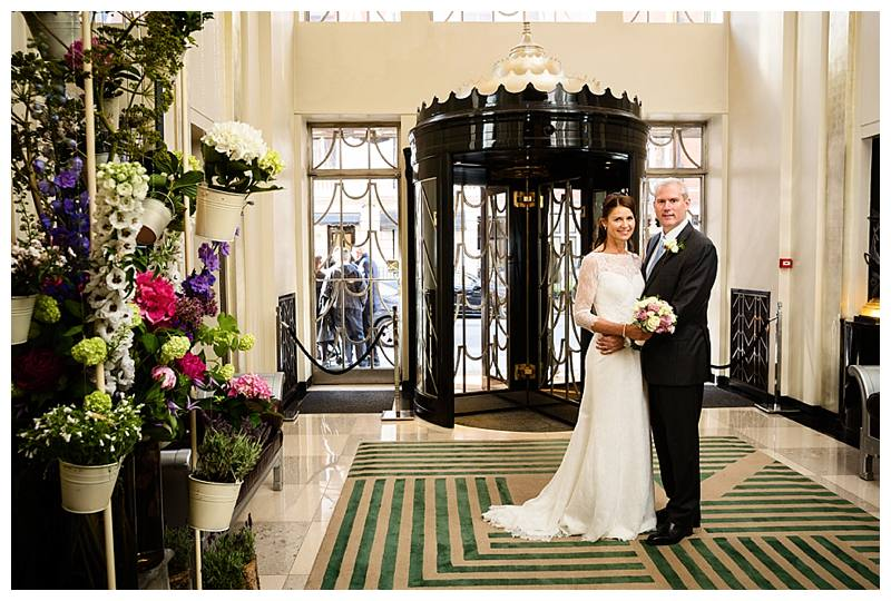 Claridge's summer wedding couple in entrance hall