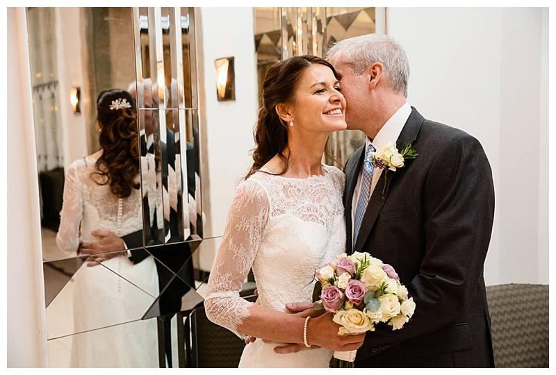 Claridge's summer wedding mirrored hallway