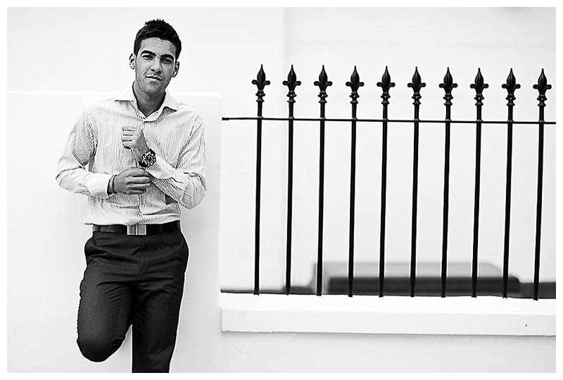 Portrait Photographer London man in white shirt by railings
