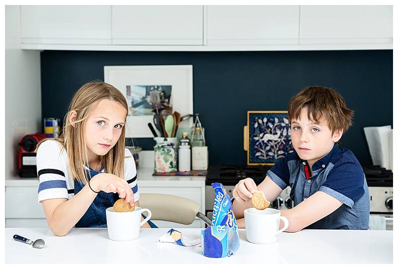 Family photography London Brother and sister dunking biscuits in tea