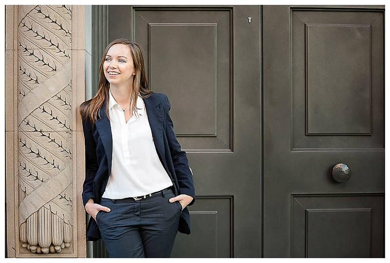 Portrait Photographer London lady in trouser suit against doorway