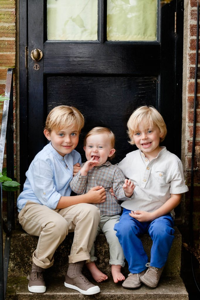little blond brothers on steps