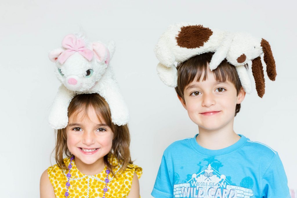 twins with cuddly toys on heads