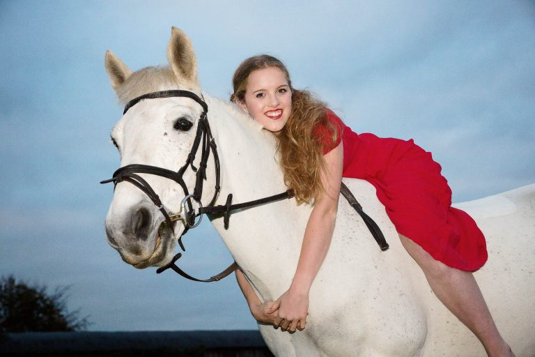 Girl in red dress on horse
