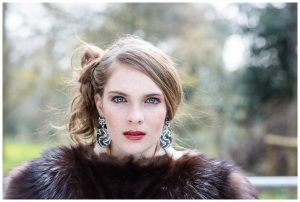 image of young woman in fur coat outdoors