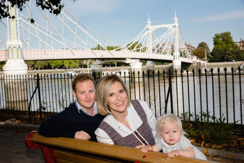mum dad and baby in front of albert bridge