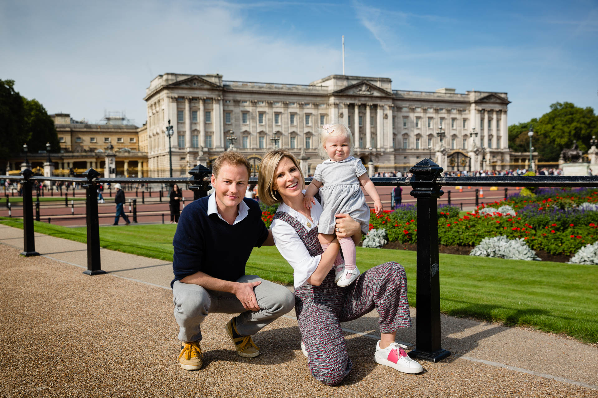 family in front of buckingham palace