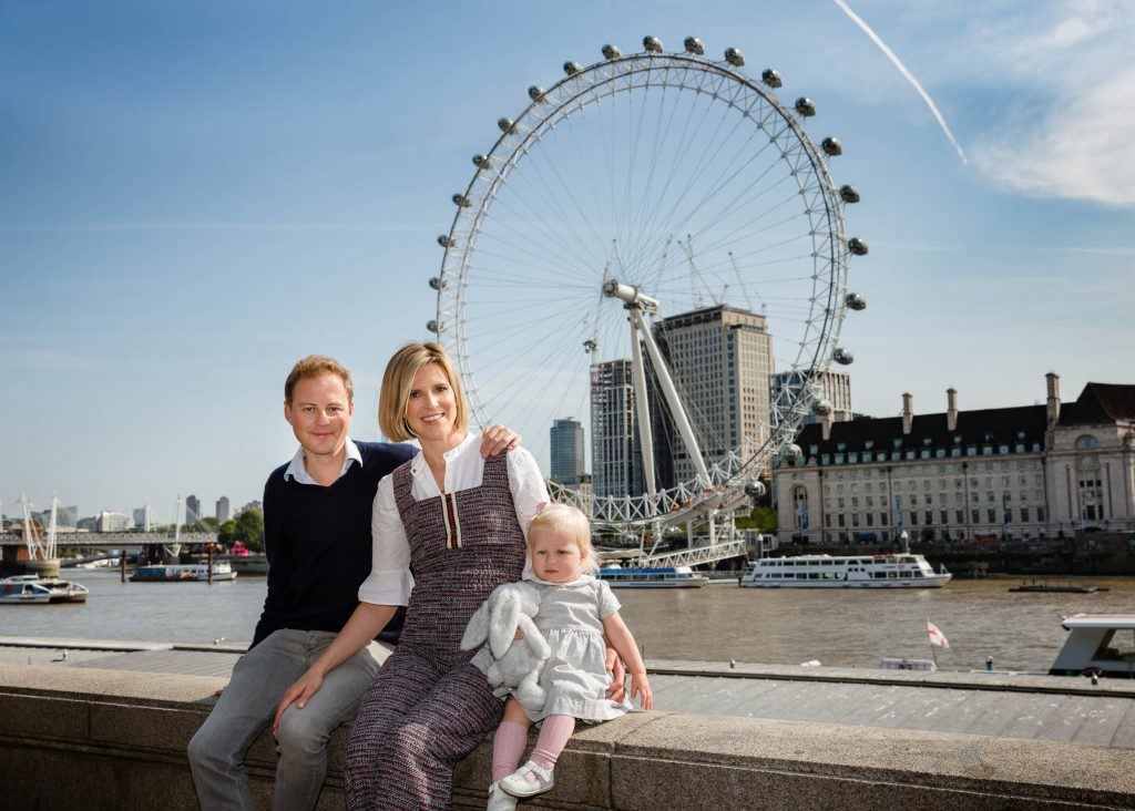 mum, dad and baby in front of the London Eye