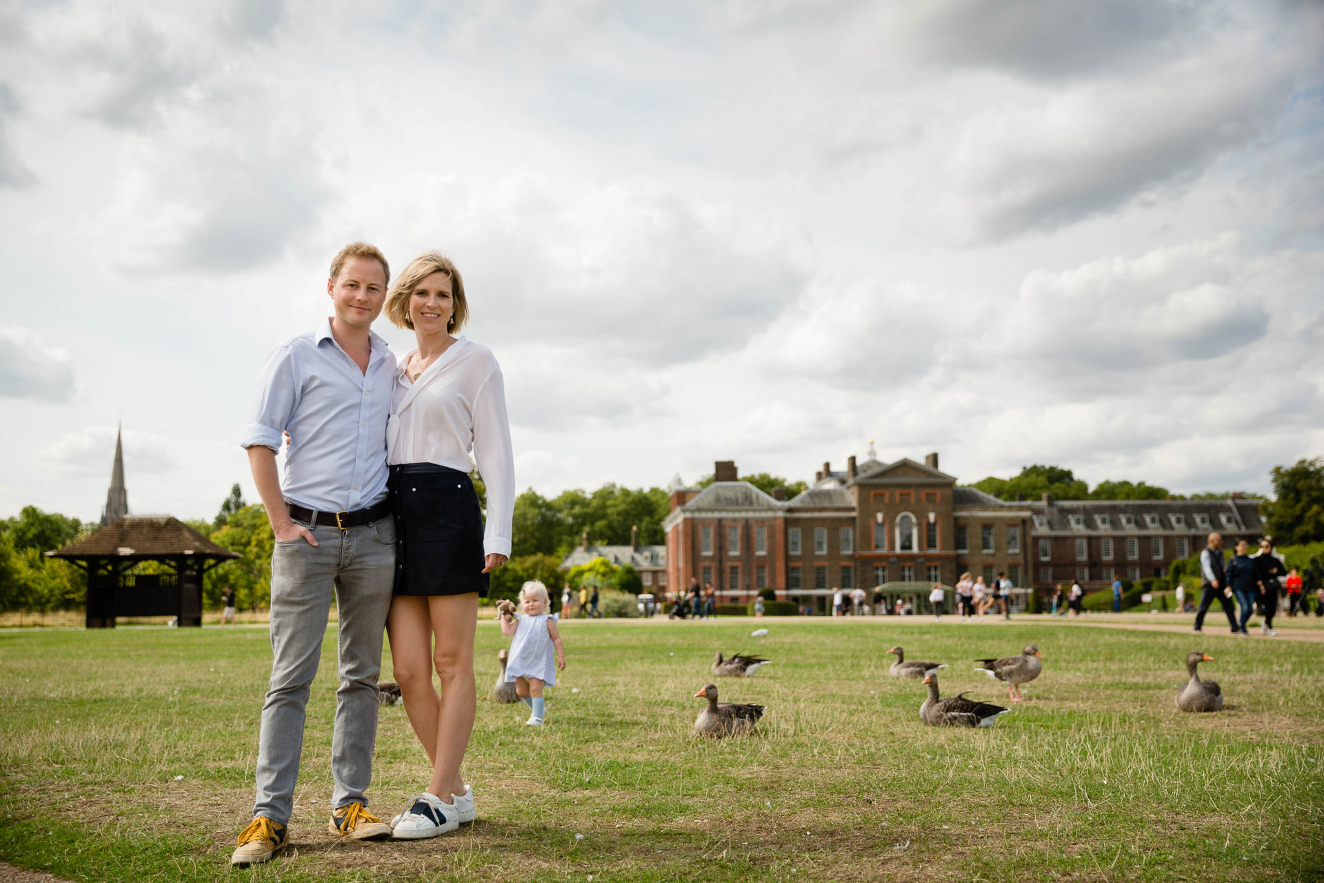 family in front of Kensington Palace