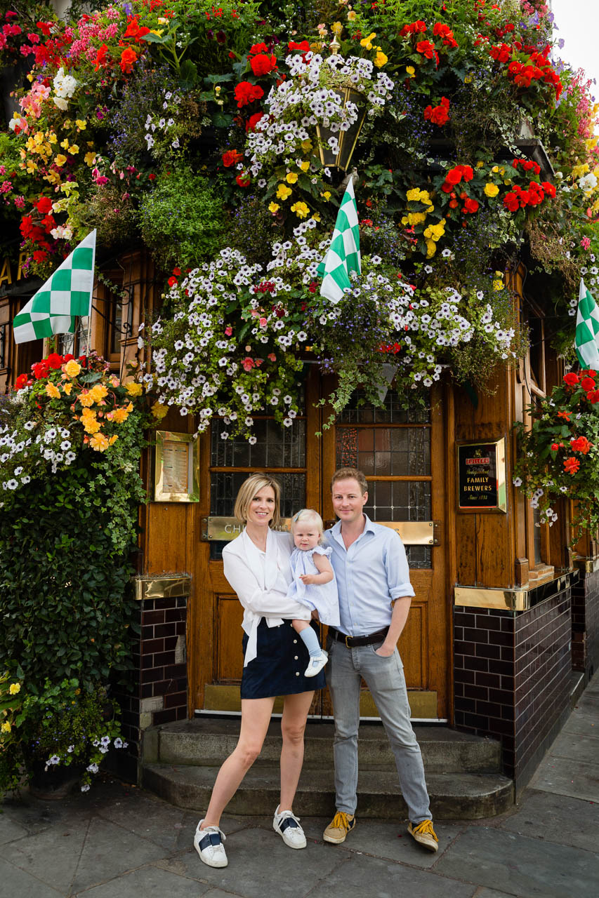 mum, dad and daughter in front of pub
