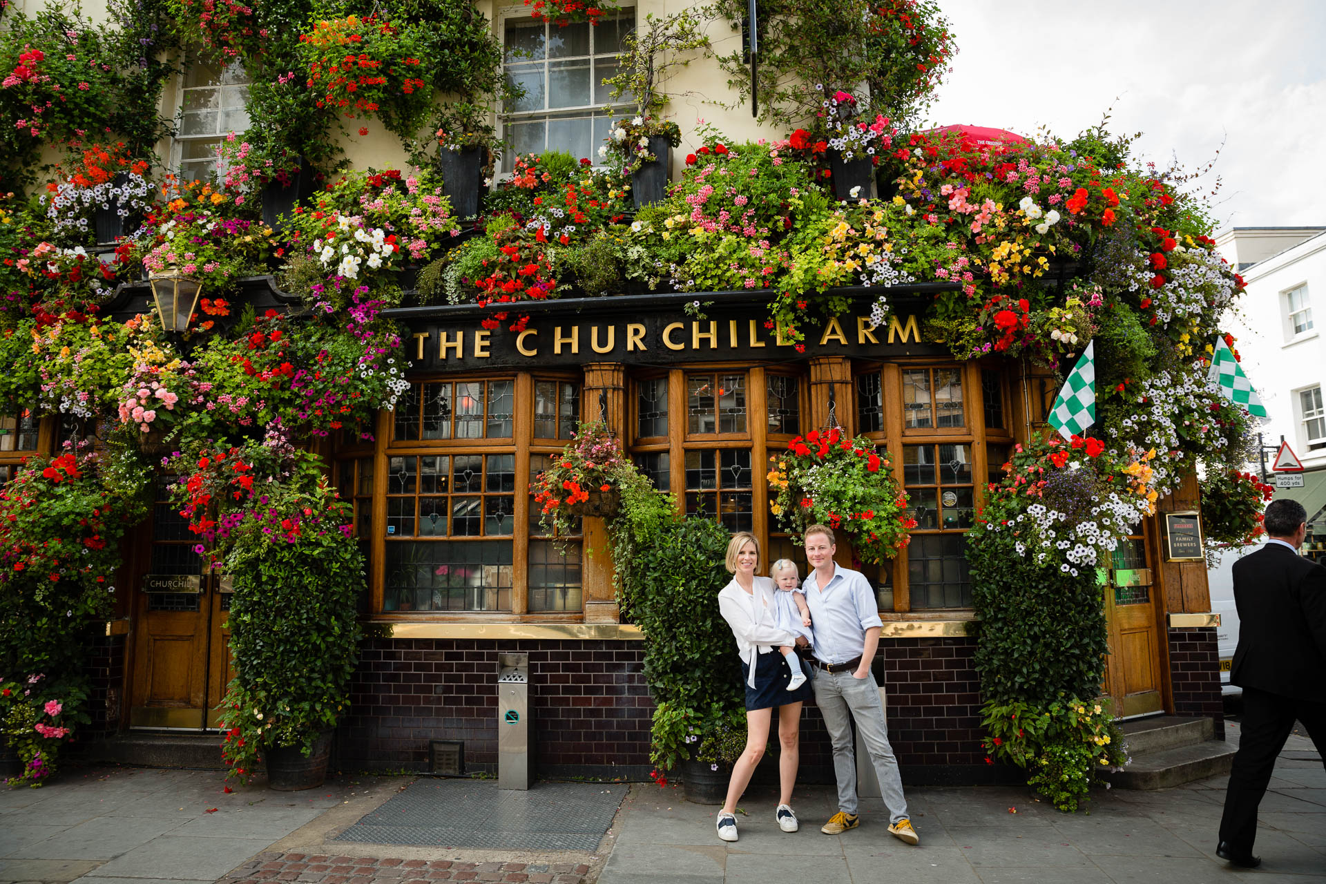 london photoshoot in front of pub with flowers