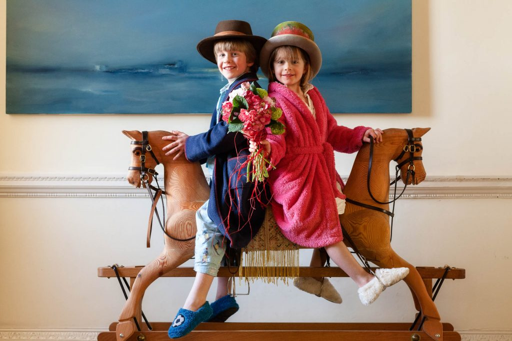 Family photography London children on a hobby horse