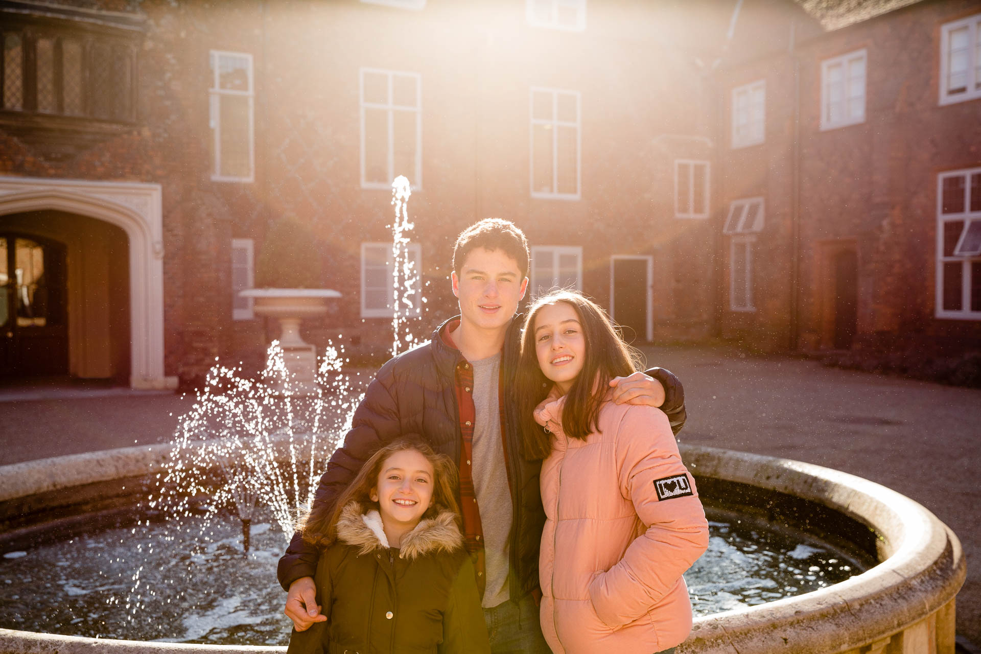 three siblings by fountain