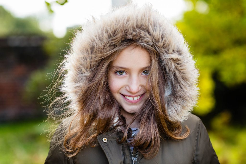 young girl with fur trimmed hood