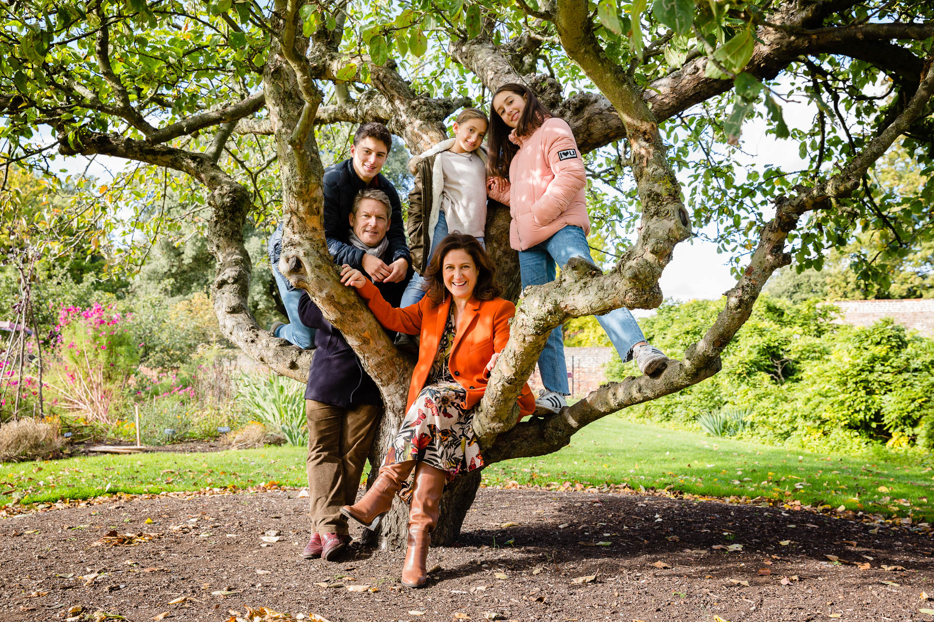 autumnal family portrait of family in tree