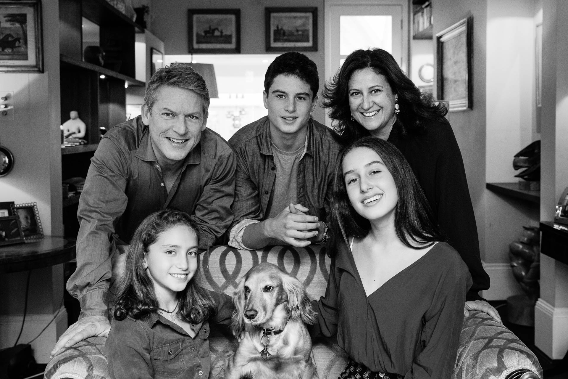 family portrait on sofa with dog