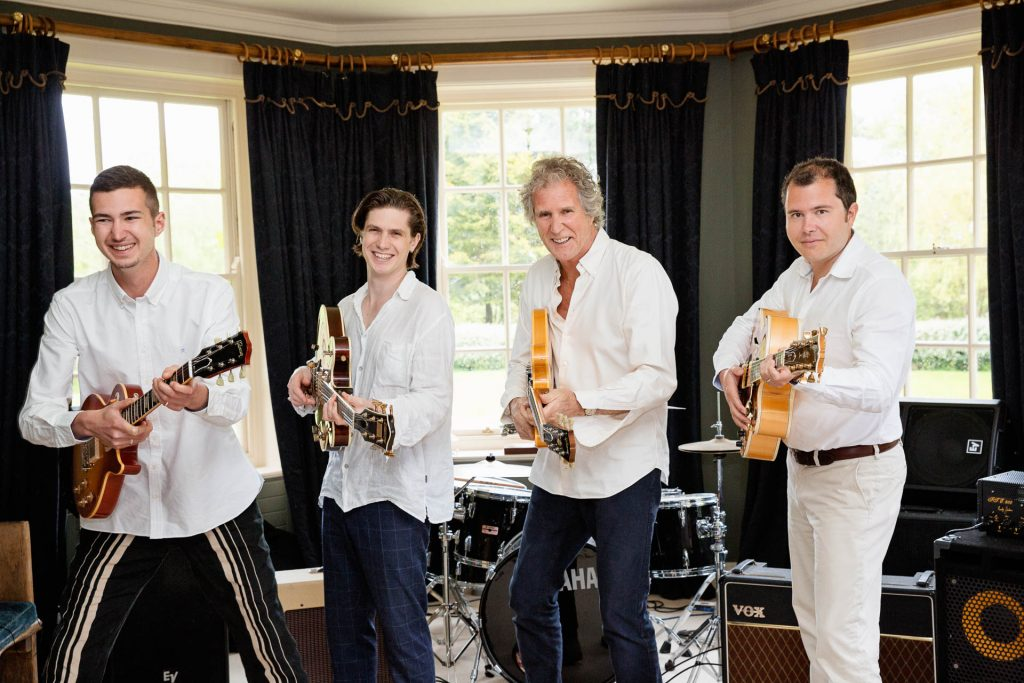 father's day photoshoot father and sons with guitars