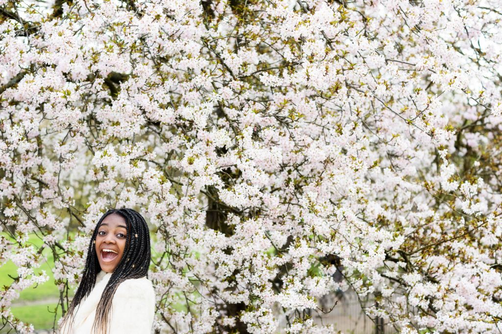 teen in spring blossoms