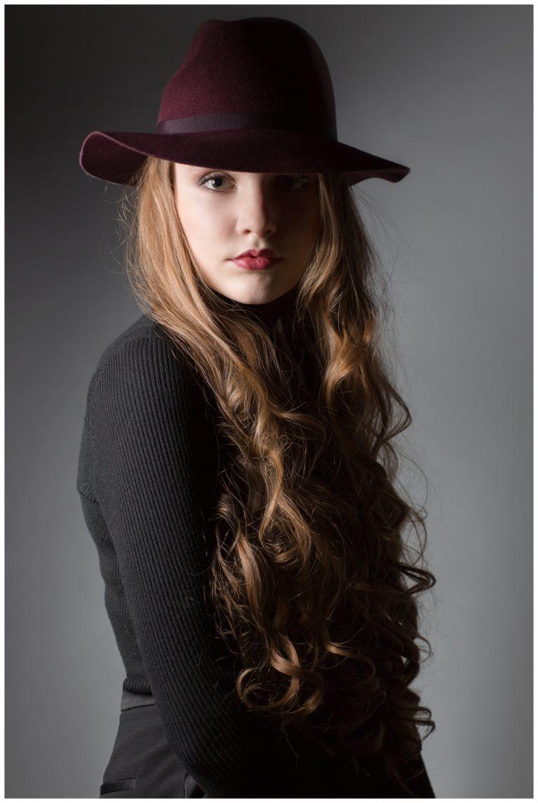 Teen portrait of girl in hat in studio