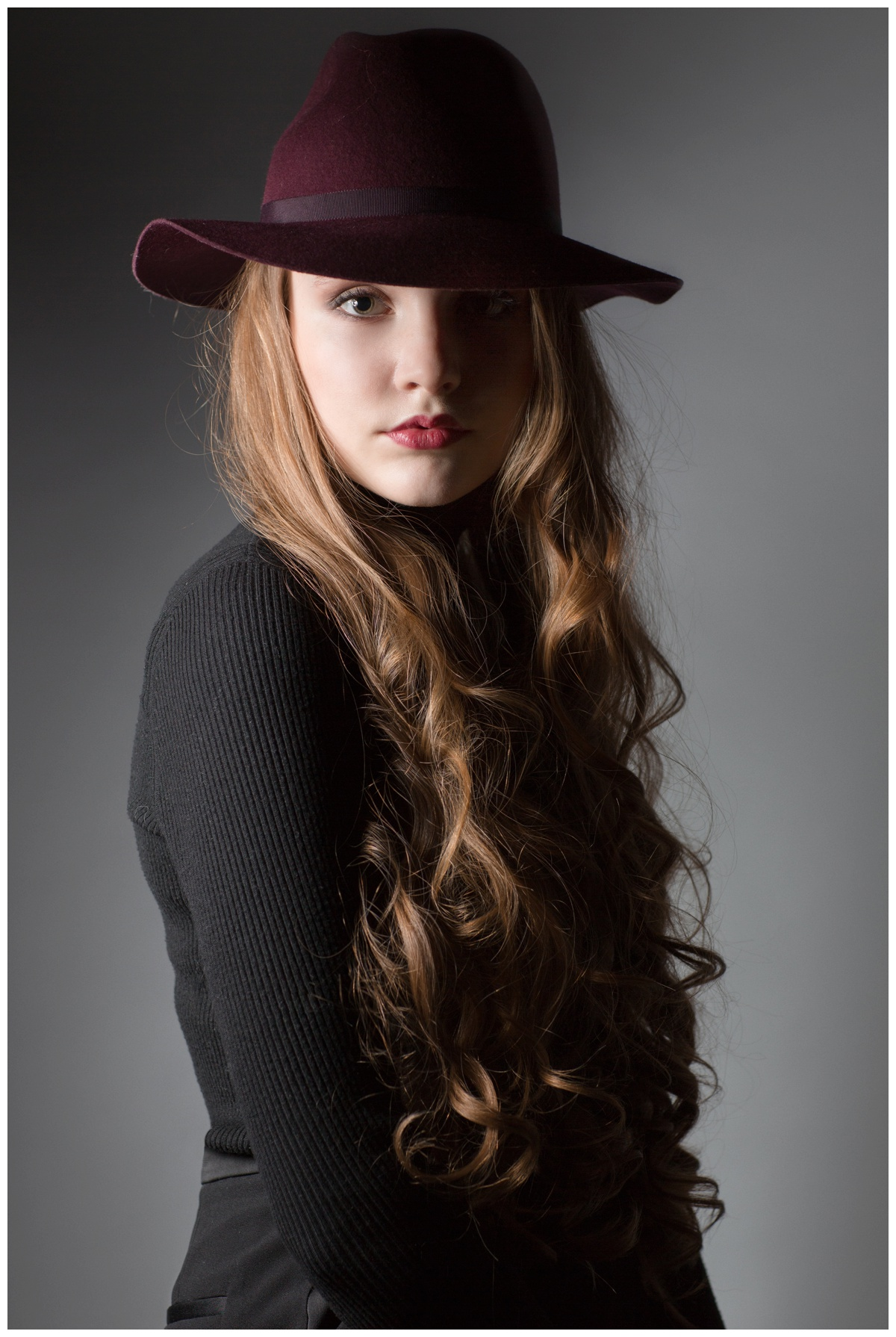 Teen portrait of girl in hat in studio