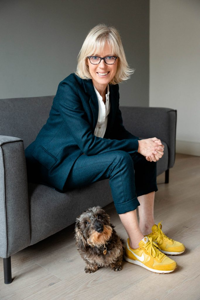 personal brand photography of lady in blue suit with yellow trainers