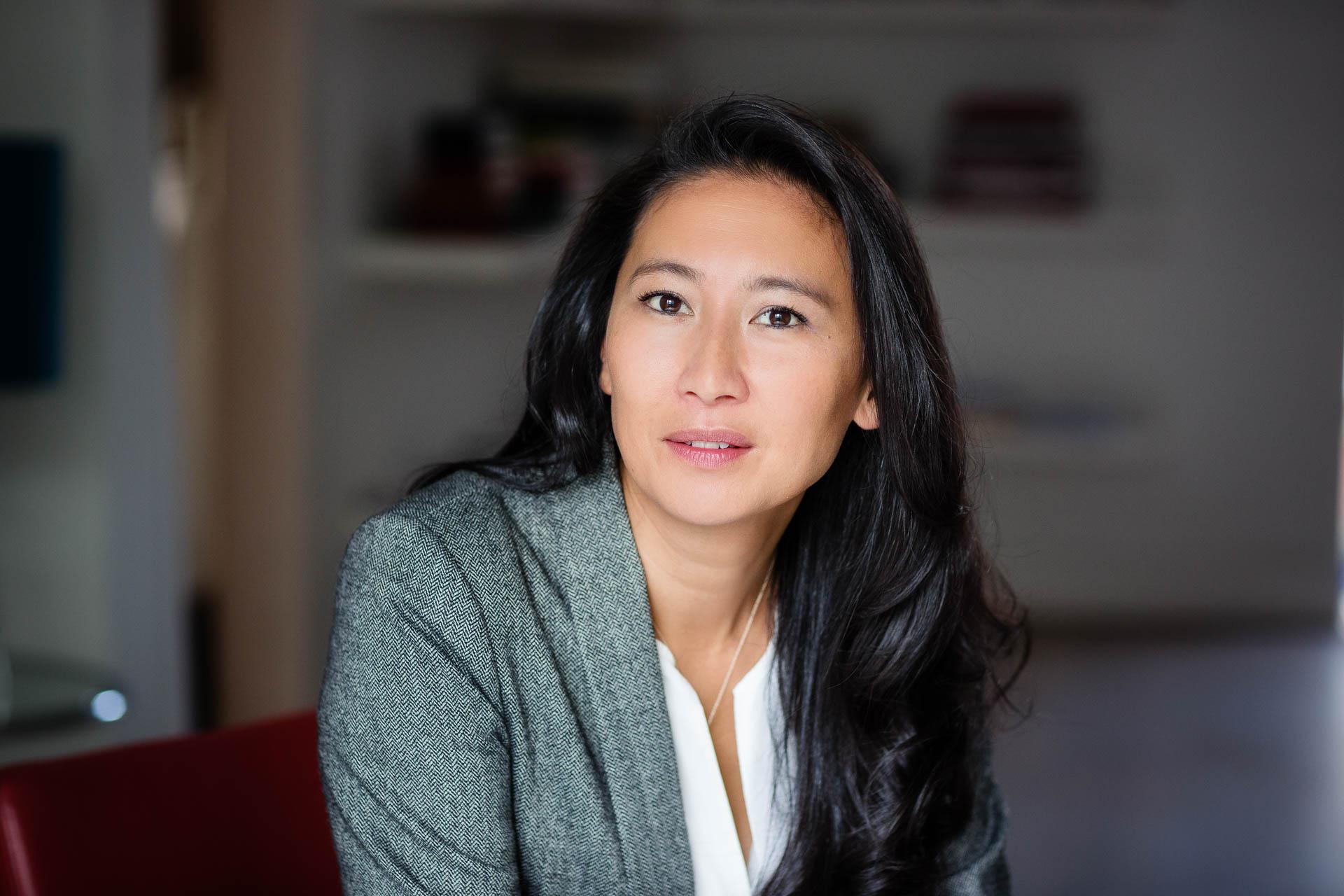 studio portrait of businesswoman in suit with long dark hair