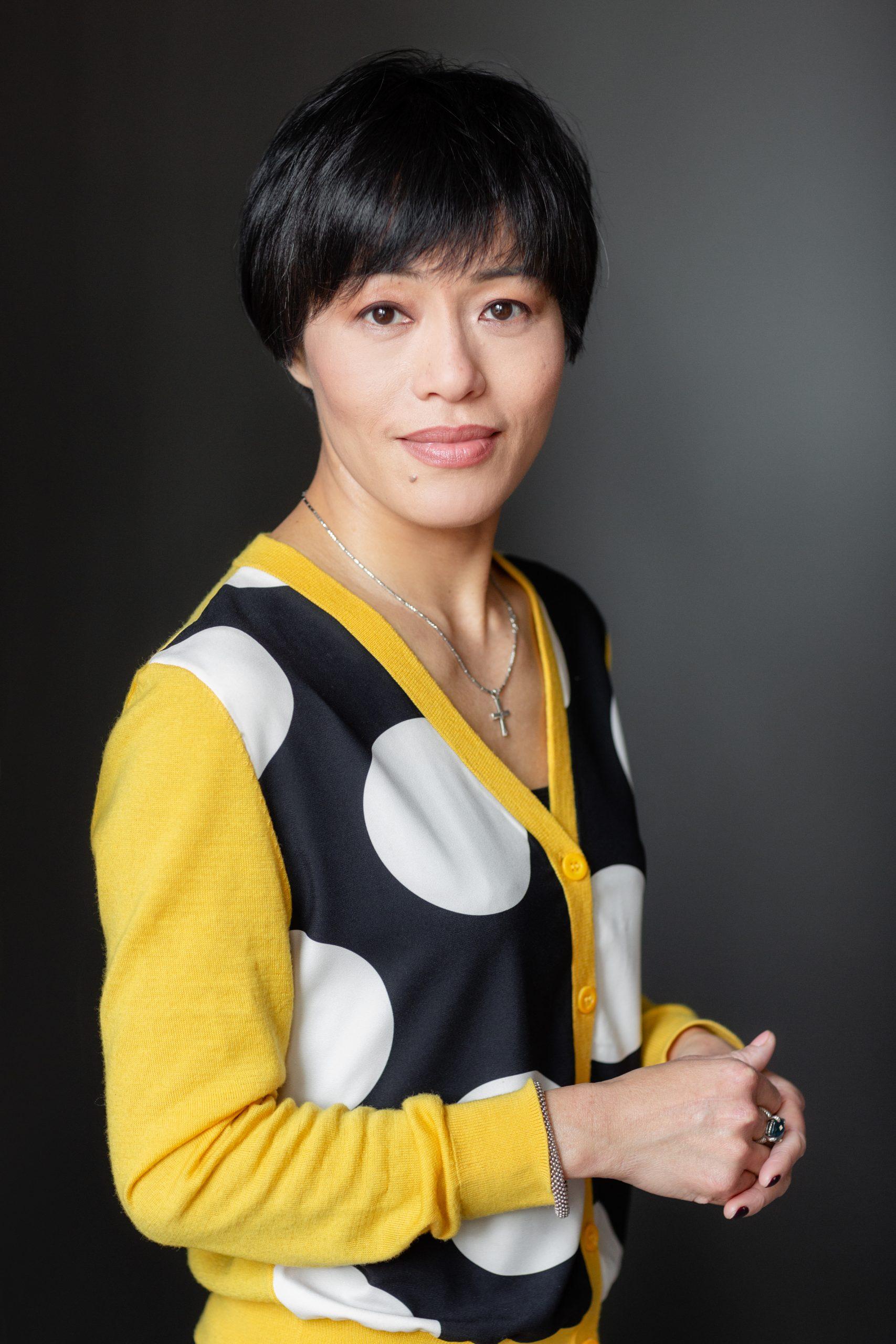 Studio portrait of woman in spotty jumper