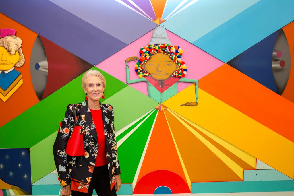 personal brand photography lady photgraphed against mural at Frieze art show