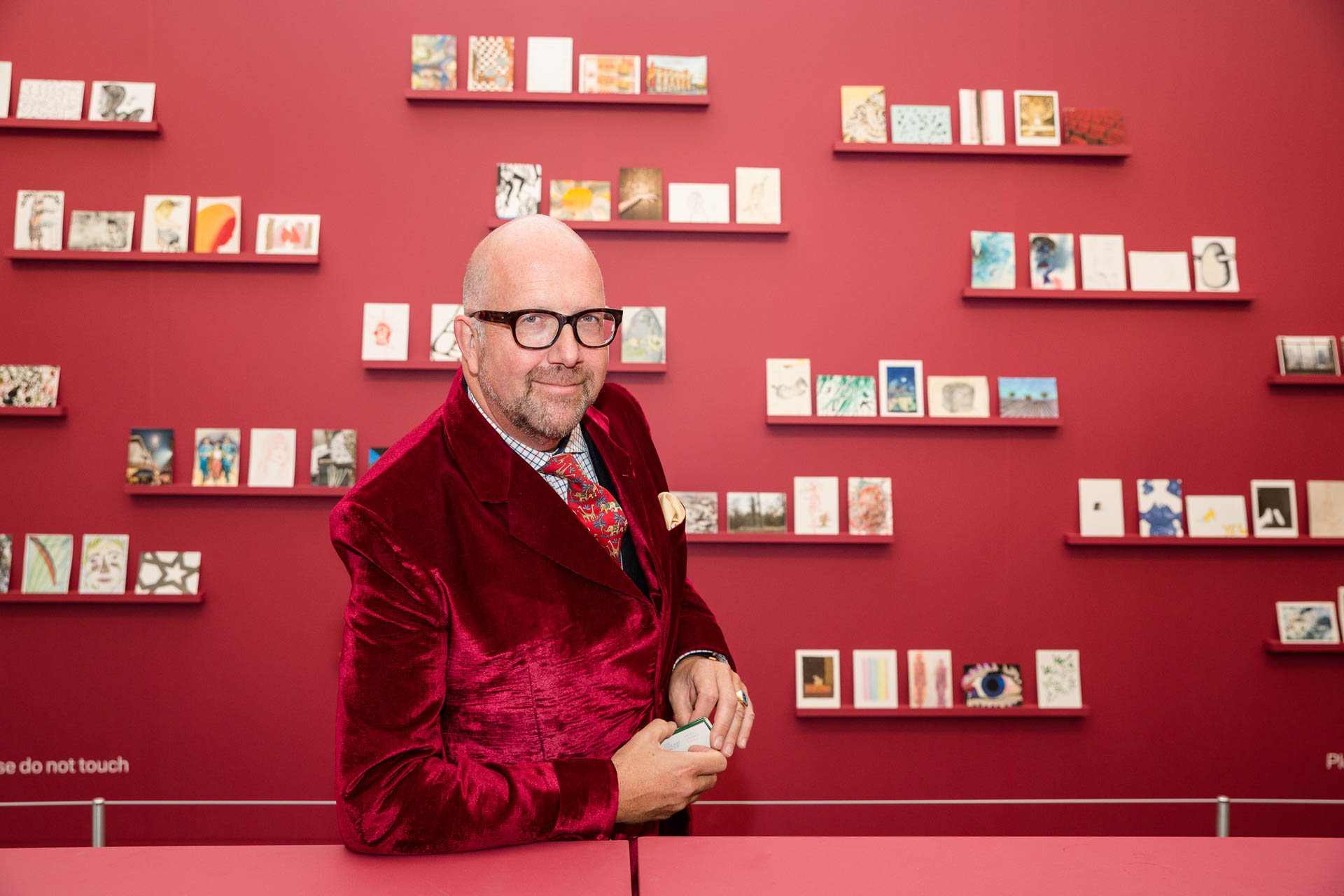 personal brand photography man in red velvet suit at Frieze art fair