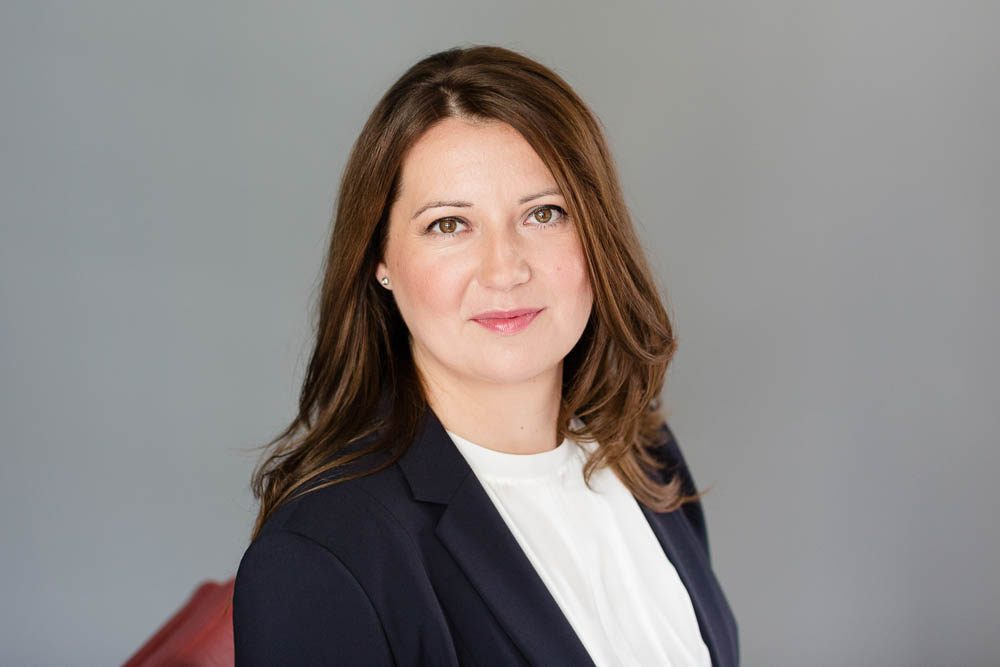 headshot of woman in suit
