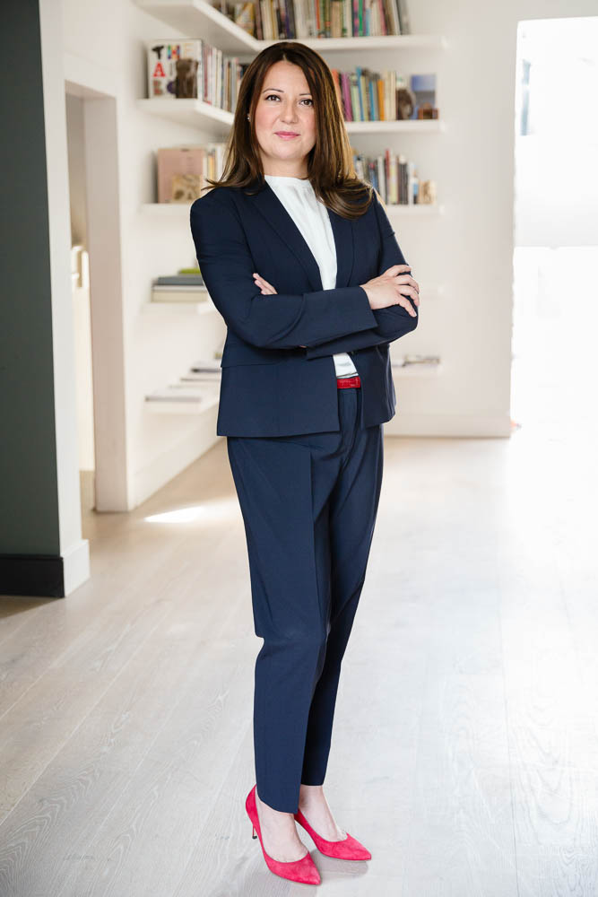 personal brand portrait businesswoman in blue suit red shoes
