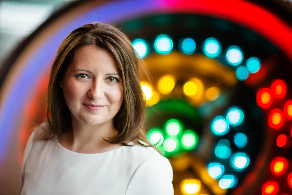 personal branding portrait of woman in front of arcade games