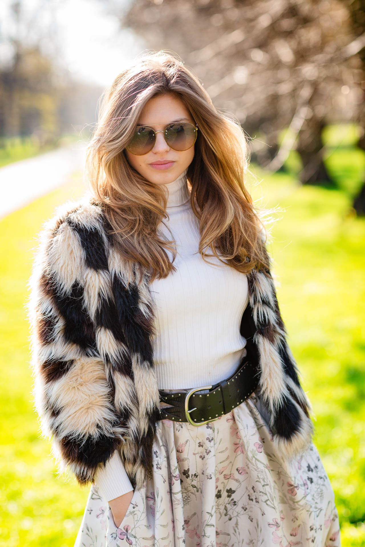 portrait of woman in holland park with fur coat