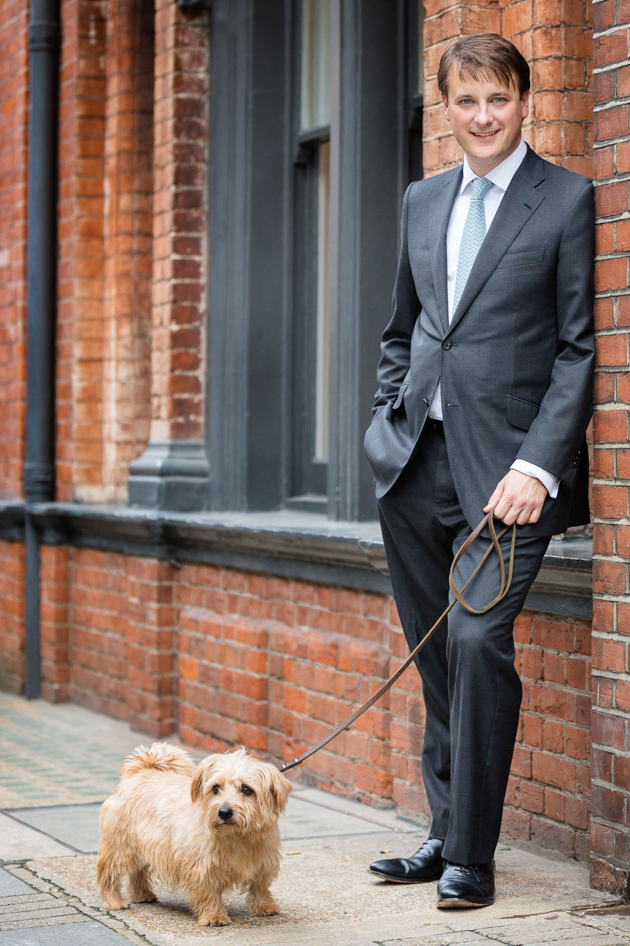 corporate portrait of businessman and his dog