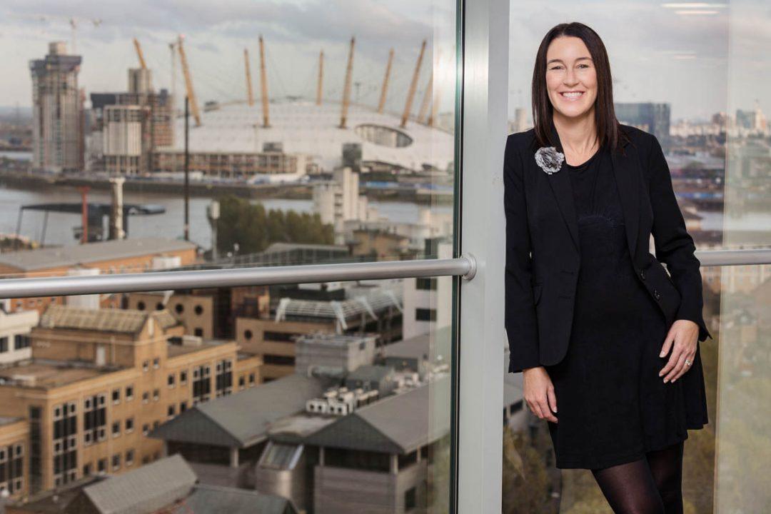 corporate portrait of woman overlooking London