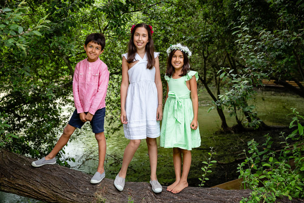 outdoor portrait photography of children in a woodland