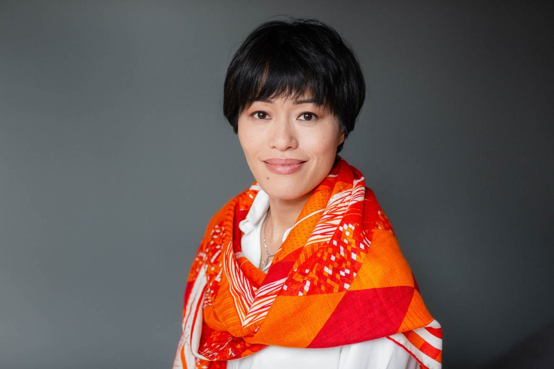 portrait of woman in orange scarf