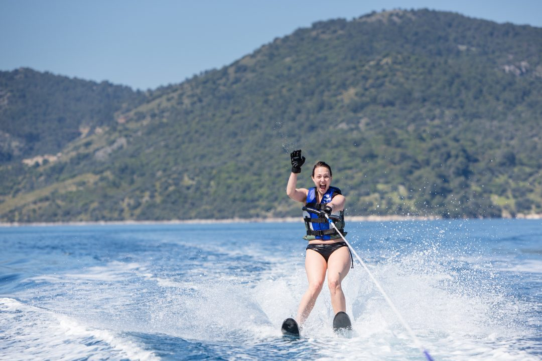 holiday photo of woman waterskiing