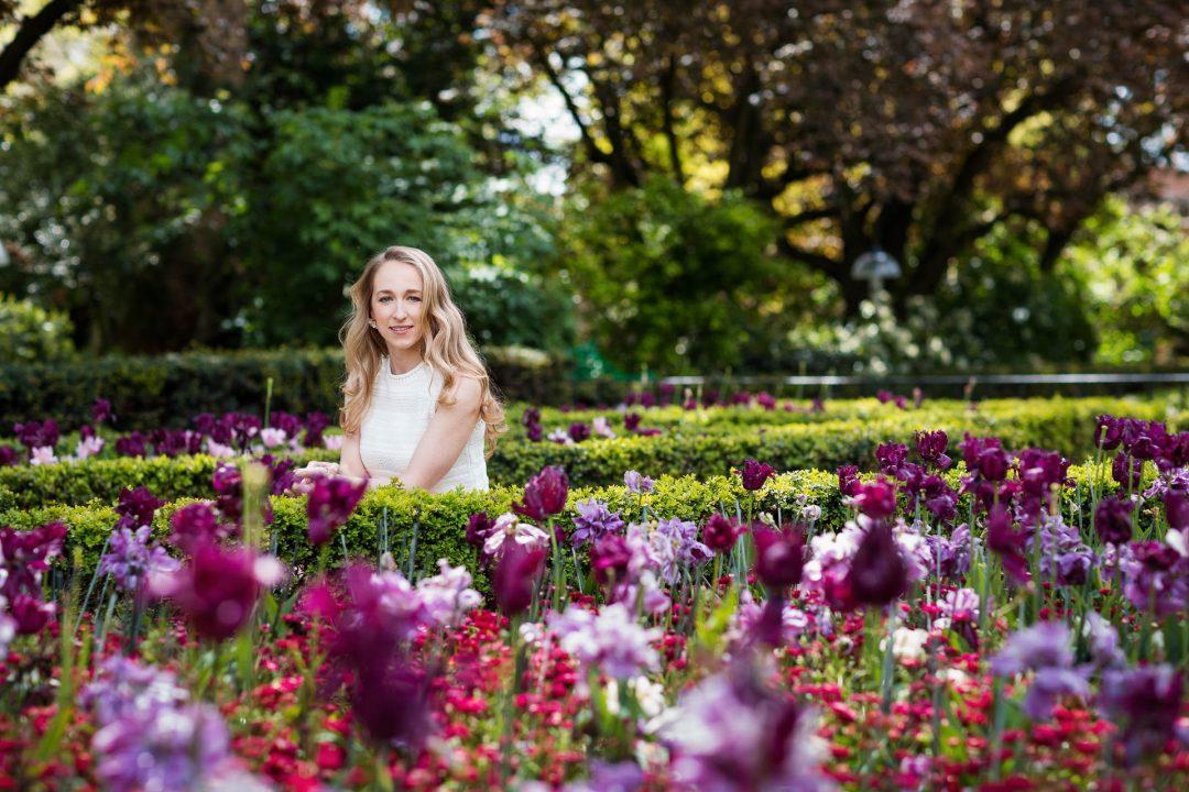outdoor portrait shoot woman amongst tulips